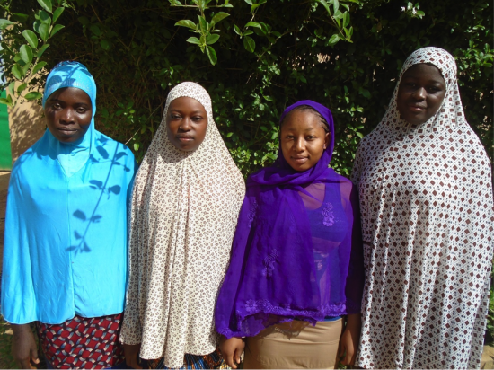 Four graduates from Secondary School, July 2015